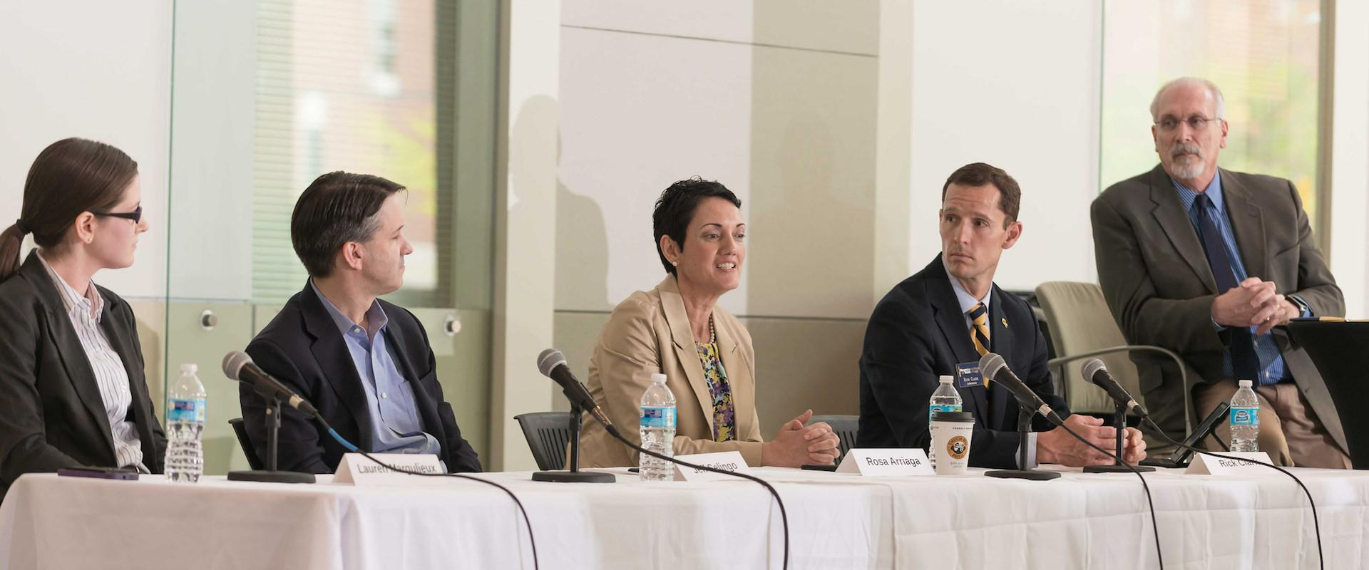 Image of five C21U staff members on a panel
